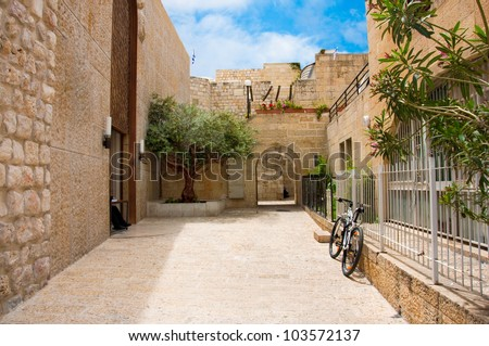 Narrow stone streets of ancient Jerusalem, Israel - stock photo