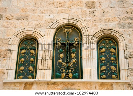 Narrow stone windows of ancient Tel Aviv, Israel - stock photo