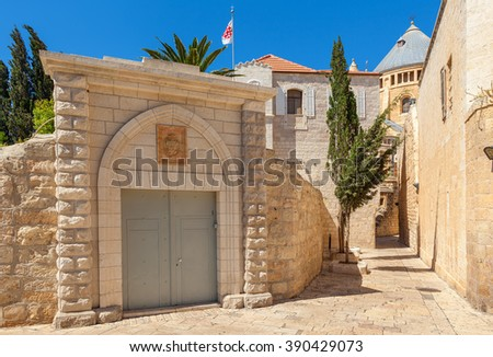 Narrow street between ancient walls and convent of San Francisco in Old City of Jerusalem, israel. - stock photo