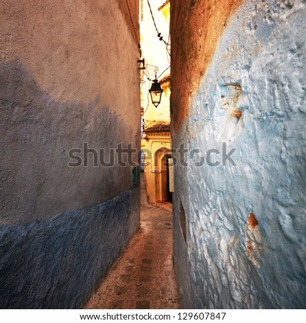 narrow street in Moroccan city, Fes - stock photo