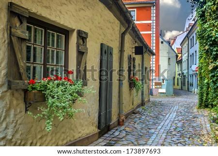 Narrow street in old Riga - capital of Latvia, Europe - stock photo