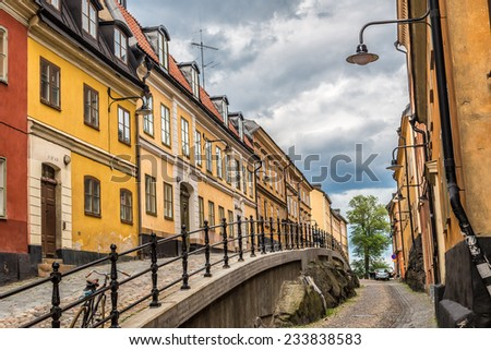 Narrow Street in Old Town (Gamla Stan) of Stockholm, Sweden - stock photo