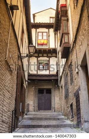 Narrow Street in Old town of Toledo - former capital city of Spain - stock photo