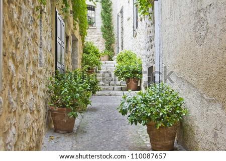 Narrow street in provence - stock photo