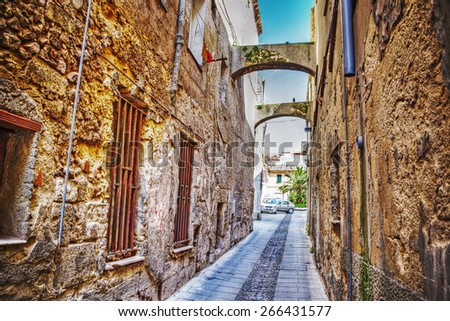 narrow street in Sassari old town in hdr tone mapping effect - stock photo