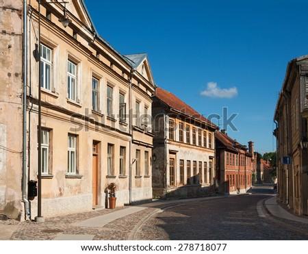 Narrow street in the ancient town of Kuldiga, Latvia - stock photo