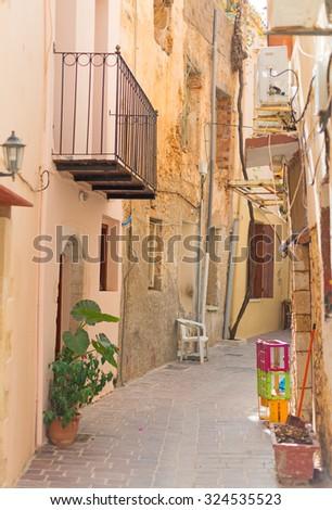 Narrow street in the centre of Chania. - stock photo