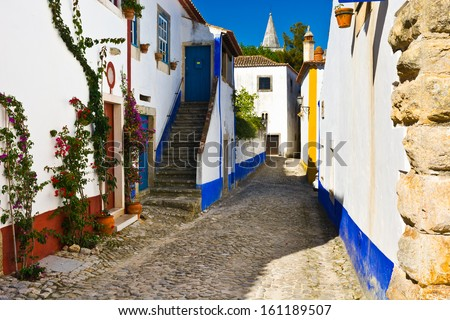 Narrow Street in the Medieval Portuguese City of Obidos - stock photo