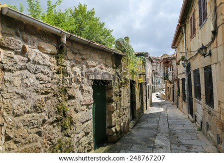 Narrow street in the old center of Tui, a border town with Portugal in the region of Galicia, Spain. - stock photo
