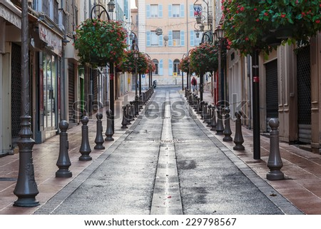 Narrow street in the old town Antibes in France. - stock photo