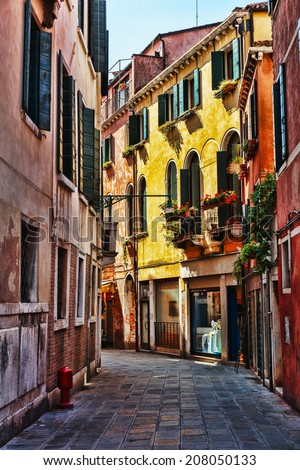 Narrow street in the old town in Venice Italy - stock photo