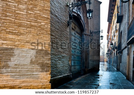 Narrow Street in Zaragoza, Rainy Day - stock photo