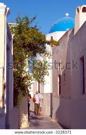 narrow street traditional greek village Oia Santorini - stock photo