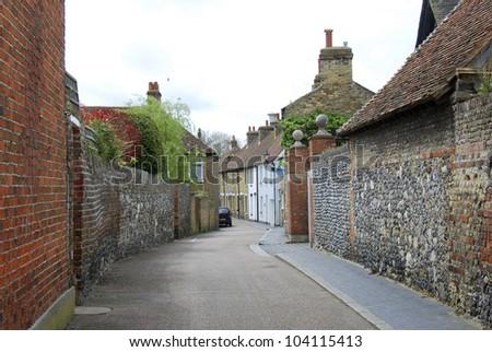 Narrow street with ancient walls, Sandwich, Kent, UK - stock photo