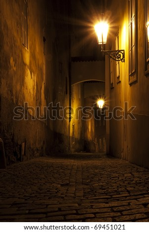 narrow street with archway in Prague, Czech, at night - stock photo