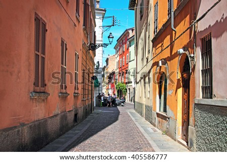 Narrow street with colorful architecture in Parma, Emilia Romagna region, Italy. Summertime. - stock photo