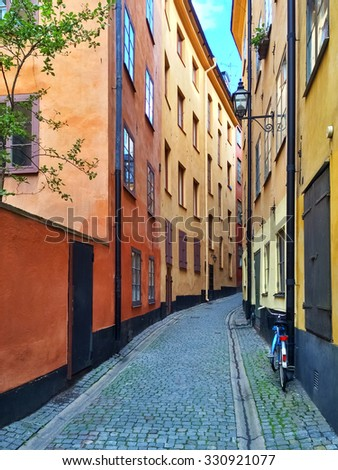 Narrow street with colorful buildings in Gamla Stan, historic center of Stockholm. - stock photo