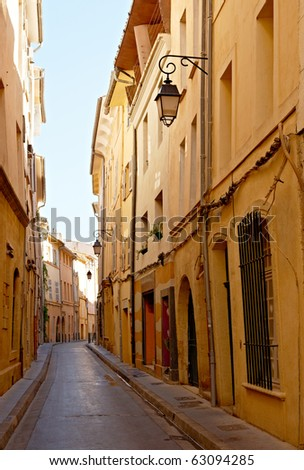 Narrow street with typical houses in Aix en Provence, France - stock photo
