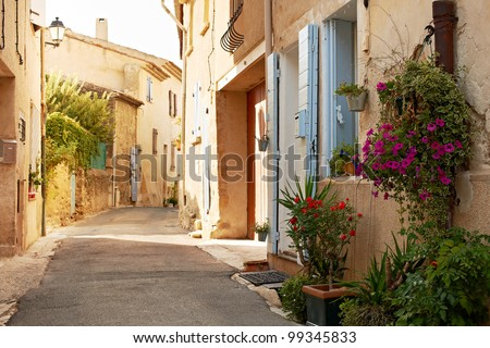 Narrow street with typical houses in village of Ansouis, Provence, France, region Luberon - stock photo