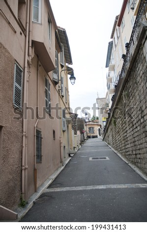 Narrow streets and high strairs  Cannes France - stock photo