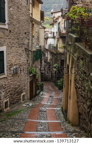 Narrow streets in Dolceacqua is a scenic medieval town in the Province of Imperia, Liguria, Italy - stock photo