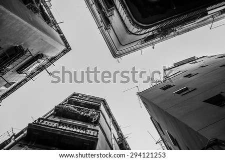 narrow streets of barcelona forming a cross in the sky - stock photo