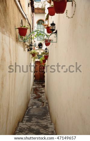 narrow white dead end street - stock photo