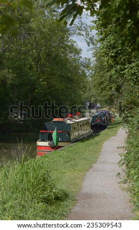 Narrowboats on the Kennet and Avon Canal in Devizes. Wiltshire. England. - stock photo