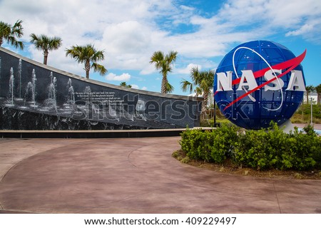 NASA Kennedy Space Center CAPE CANAVERAL, FLORIDA. Kennedy memorial next to the Nasa globe. - stock photo