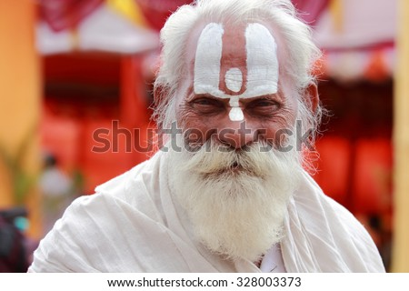 NASHIK - SEP 17:An unidentified Sadhu looks as he participates in the event Maha Kumbh Mela on September 17, 2015 in Nashik, India.Kumbhmela is a Hindu religious event gathered by millions. - stock photo