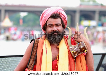 NASHIK - SEP 14:An unidentified Sadhu looks as he participates in the religious event Kumbh Mela on September 14, 2015 in Nashik, India.Kumbhmela is a Hindu religious event gathered by millions. - stock photo