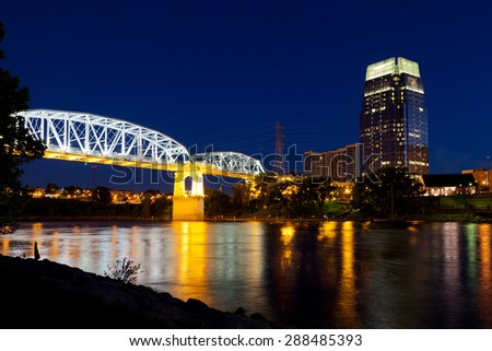 Nashville, Tennessee bridge and city skyline at dusk - stock photo