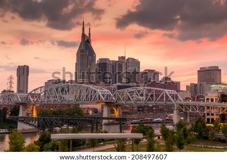 Nashville, Tennessee downtown skyline at Cumberland River at twilight. - stock photo