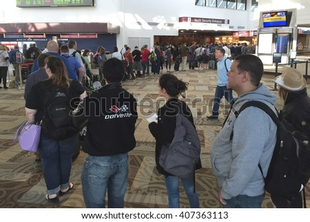 NASHVILLE, TN-APRIL 18, 2016:  Hundreds of passengers wait in the TSA security line at Nashville International Airport. The number of agents has failed to keep up with the increased passenger count. - stock photo