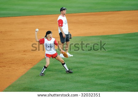 NASHVILLE, TN - June 10, 2009: Country music superstar Carrie Underwood makes a throw in the CIty of Hope softball game June 10, 2009 - stock photo