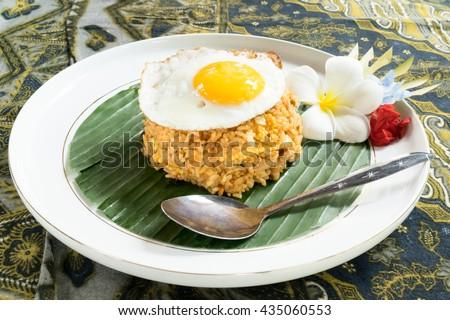 nasi goreng; Indonesian fried rice plate - stock photo