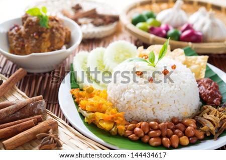 Nasi lemak, popular Malaysian food dish served with chicken rendang. - stock photo