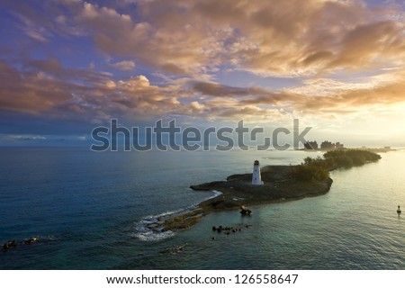 nassau bahamas at dawn with colorful clouds - stock photo