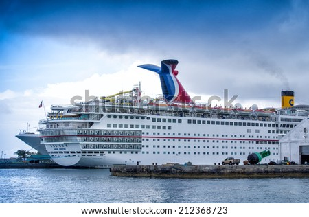 NASSAU, BAHAMAS - CIRCA FEBRUARY, 2012: Cruise ships docked at the Bahamas port of call. Most cruise lines include the islands of the Bahamas as a destination point on their itineraries - stock photo