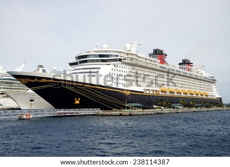 NASSAU, BAHAMAS, DECEMBER 2, 2014: World famous Disney Dream cruise ship docked at the Port of Nassau taking thousands of tourists with Disney's magic to the Caribbean during the holiday season. - stock photo