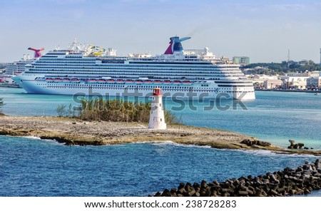 NASSAU, BAHAMAS - JAN. 13, 2013: Carnival Dream entering the port of the Bahamas. At 130,000 tons, the ship is the largest to date for Carnival Cruise Lines. - stock photo