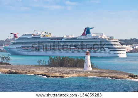 NASSAU, BAHAMAS - JAN.13:  Carnival's Dream cruise ship in port of Bahamas on Jan 13, 2013.  Carnival Cruise Lines frequents the Bahamas as it's one of the world's most famous travel destination. - stock photo