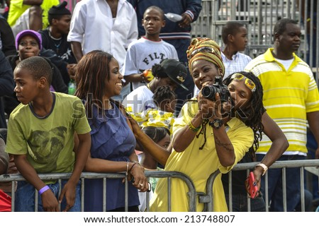NASSAU, THE BAHAMAS - JANUARY 1: Spectators at Junkanoo Festival on January 1st 2014 in Nassau, the Bahamas - stock photo