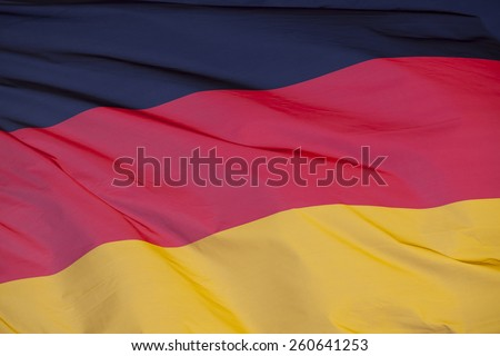 National flag of Germany. Image of German national flag flaying in the wind. - stock photo