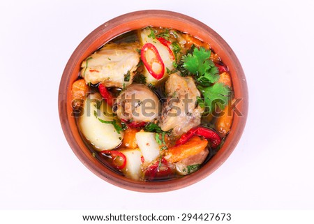 national food roast with potatoes and chicken, turkey, bird, foot, game with green onion, carrot, tomato - stock photo