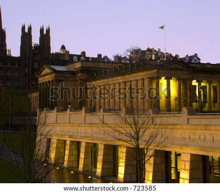 National Gallery on Princes Street and skyline of the Royal Mile in Edinburgh, Scotland at sunrise - stock photo