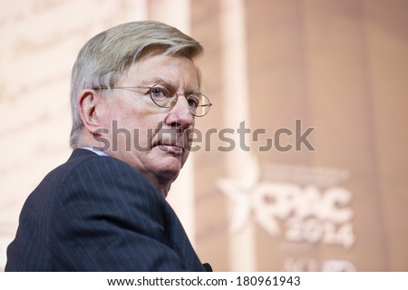 NATIONAL HARBOR, MD - MARCH 6, 2014: Columnist George Will speaks at the Conservative Political Action Conference (CPAC). - stock photo