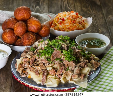 National Kazakh dishes - Beshbarmak, salad of radish Shalgam, and for dessert Baursak. - stock photo
