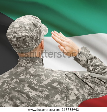 National military forces with flag on background conceptual series - Kuwait - stock photo