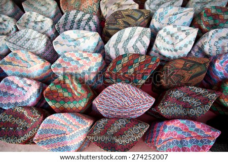 National Nepalese Topi cap at the market. A topi is a cap that is worn in India, Bangladesh, Pakistan, and other regions of South Asia.  - stock photo